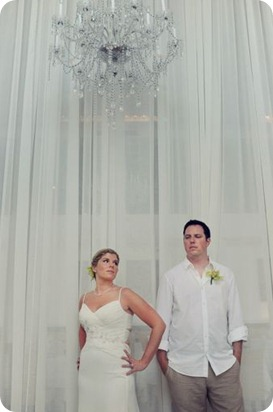 White draping with crystal chandelier wedding