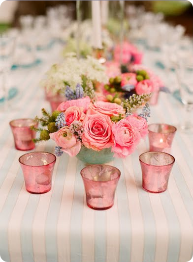 garden wedding centerpiece with pink roses and pink votive holders