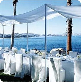Outdoor destination wedding reception by the water