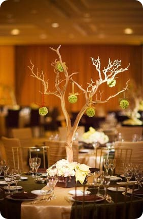 Branch Tree centerpiece with small green poms pomanders hanging