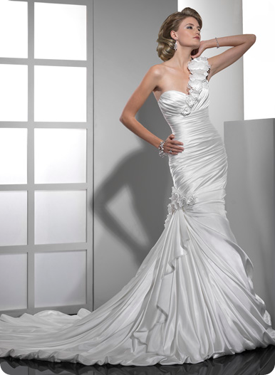 uched Demir Stretch Satin dramatically descends down the body, flaring at the knee to create this slender, fit and flare silhouette. Handmade flowers enrich the sweetheart neckline and side skirt with a fluted side drape reaching to the bubble hem.