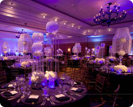 wedding reception with lighting and crystal centerpieces black linens