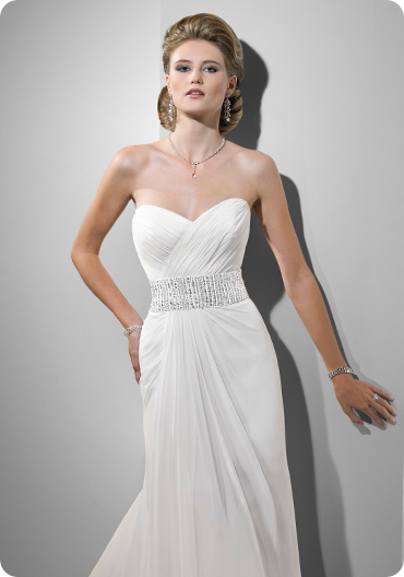 Gossamer Chiffon creates this slender A-line gown with a dramatically ruched criss-cross bodice and sweetheart neckline. Delicate lines of glistening beads and Swarovski crystals define the waist. The signature corset closure completes the design.
