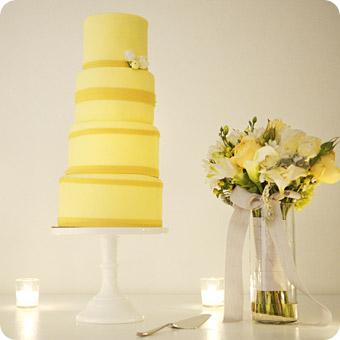 Round Yellow Wedding cake with Yellow Ribbon on white cake stand