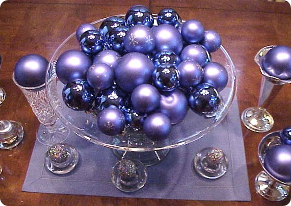 Purple ornaments in matte and glossy finishes fill crystal bowls, flutes and tealight holders