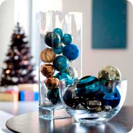 Ornaments filled in tall square vase and glass bowl offer dimension