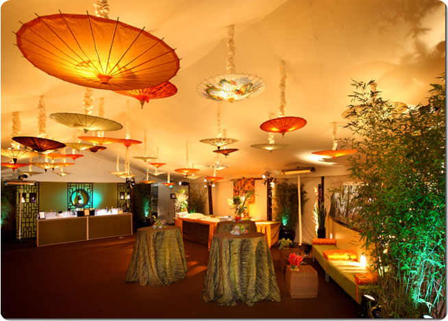 Hanging Parasols as lighting in tent for weddings and events
