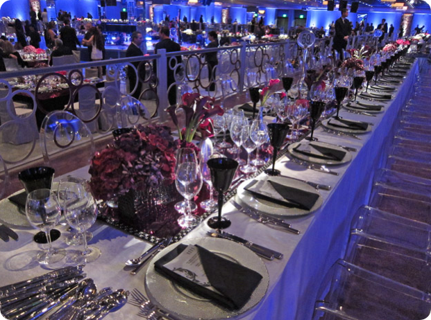 burgundy and merlot centerpieces with calla lilies and other flowers with black goblets
