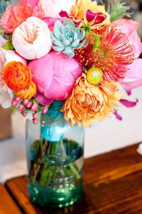 peonies, mums, ranunculus succulent centerpiece arrangement in mason jar