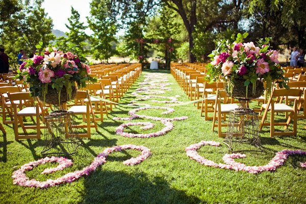 outdoor wedding ceremony with chiavari chairs and sculpted petal aisle