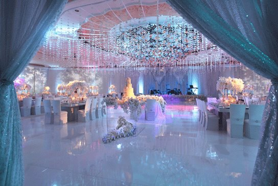 elegant ethereal wedding with uplighting linens and florals