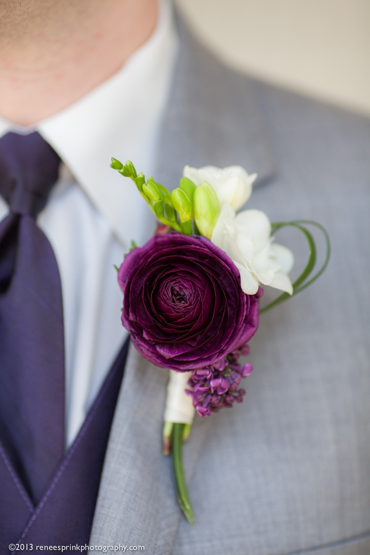 purple ranunculus wedding boutonniere