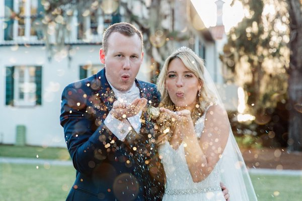 bride and groom blowing gold glitter at the Jekyll Hotel Club